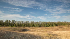 The formation of clouds over autumn endless green fields of grass Stock Footage