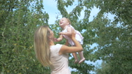 Mom throws up baby into the air. Stock Footage