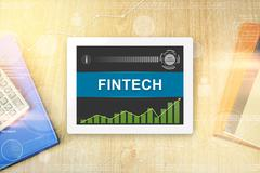 Fintech or financial technology word on tablet Stock Photos