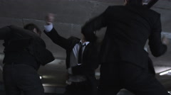 4K Asian gangster fighting in dark parking lot with members of a rival gang Stock Footage