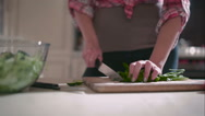 Woman chops parsley for the salad Stock Footage