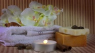 Spa Concept with orchid,towel,soaps and candle Stock Footage