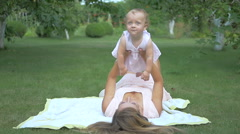 Mother and daughter lying on the bedspread. Stock Footage