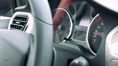 Detail of dashboard and steering wheel in the car - somebody drive a car Stock Footage