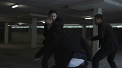 4K Asian gangster fighting in parking lot with members of a rival gang Stock Footage