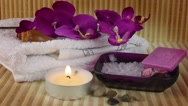 Spa Concept with orchid,towel,soap,beauty salt and candle Stock Footage