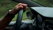 Man drives a car in the countryside - detail of steering wheel with hand Stock Footage