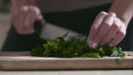 Woman prepares salad on the cutting board Stock Footage