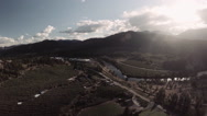 Aerial: Scenic Rural Valley with Farmlands and Rivers on Bright Afternoon Stock Footage