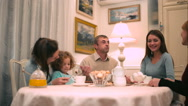 Family have a conversation while drinking tea Stock Footage