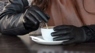 Woman with gloves stir with spoon a cup great cappuccino Stock Footage