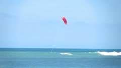 Kite surfer swimming on board in sea, super slow motion 240fps Stock Footage