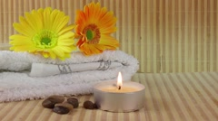Spa Concept with flowers,towel and candle on bamboo background Stock Footage