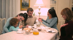 Women play with child at the table Stock Footage