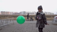 Child staying with balloon Stock Footage