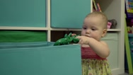 Little cute baby playing in his room Stock Footage