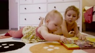 Little cute girls is playing on the floor Stock Footage