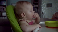 Children and nutrition, mother feeding baby girl Stock Footage
