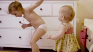 Little cute girls playing in his room. Two little girls is dancing Stock Footage