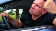 Young handsome man scolds behind the wheel in the car - nature in background Stock Footage