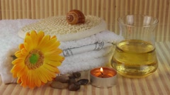 Spa Concept with flower,towel,soap,massage oil and candle Stock Footage