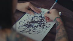 Master tattoo transfers pattern on tracing paper by pencil Stock Footage