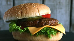 Beef hamburger grill  pickled cucumber tomato cheese Stock Footage