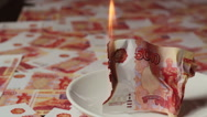 Russian banknote of 5000 rubles is burning on a saucer.Fake money. Stock Footage