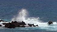 Waves crashing on lava rocks. Two play speed. Slow motion Stock Footage