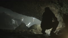 4K Team of geologists exploring underground cave, studying rock formation Stock Footage