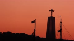 A sailboat passes under Christ the King Statue Lisbon, Portugal  Stock Footage
