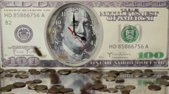 Coins are falling on the background of hundred dollar bills.Us dollars. Stock Footage