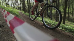 Mountainbiker rides in autumn forest Stock Footage