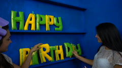Happy Birthday from felt letters on blue background Stock Footage