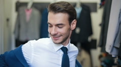 Smiling Man wearing suit at clothing tailor's shop Stock Footage