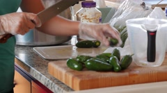 A woman chopps jalapenos for fresh salsa Stock Footage