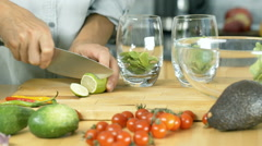 Woman cutting lime into slices while making refreshing drink, dolly shot Stock Footage