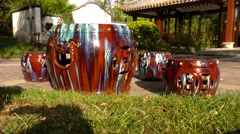 Ornamental Chinese Drums In Garden Setting Stock Footage