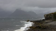 Elgol beach, Loch Scavaigand the Cuillin mountains on the Isle of Skye, Scotland Stock Footage