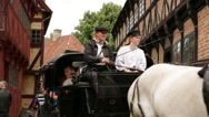 Close up of horse carriage passing by and turning in front of the camera..Sho Stock Footage