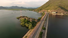 Lesendro on Skadarsko lake in Montenegro. Ancient fortifications are on island Stock Footage