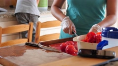 Little boy helping his mother make fresh salsa Stock Footage