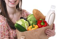 Young Woman Holding Large Bag of Healthly Groceries Stock Photos