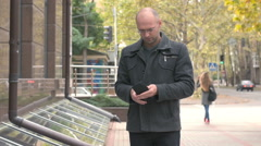 A man looks at wallet and counts the bills Stock Footage