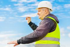 Engineer with paper airplane Stock Photos