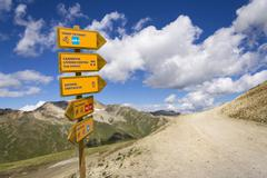 Footpath and mountain bike direction sign in Italian Alps Livigno Stock Photos