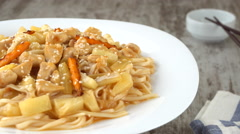 Udon-noodle with chicken and vegetables on a plate Stock Footage