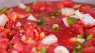 Stiring a fresh pot of vegetable salsa Stock Footage