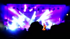 Lighting effects on a rock concert stage at night. Crowd's heads in the shadow. Stock Footage
