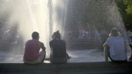 Couple talking Washington Square Park Tisch fountain on summer day in NYC 1080 Stock Footage